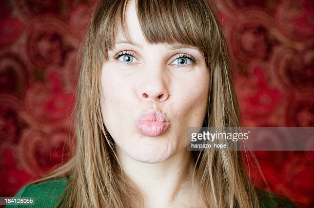Woman making a kissing face.