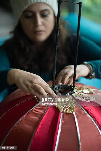 Woman making a lampshade