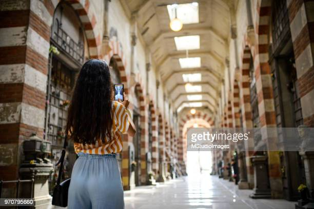 woman making a photo of a tourist place. - photo messaging stock photos and pictures