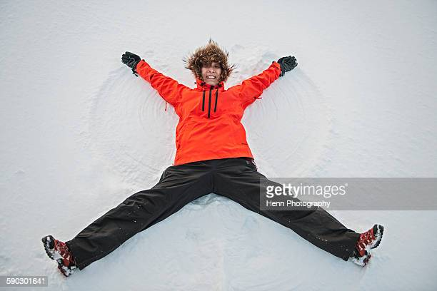woman making a snow angel in Iceland