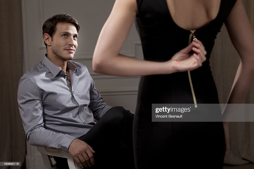 woman making a striptease stock foto getty images. Black Bedroom Furniture Sets. Home Design Ideas