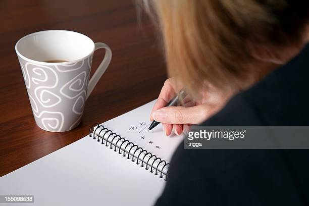 woman making a 'to-do' list - list stock pictures, royalty-free photos & images