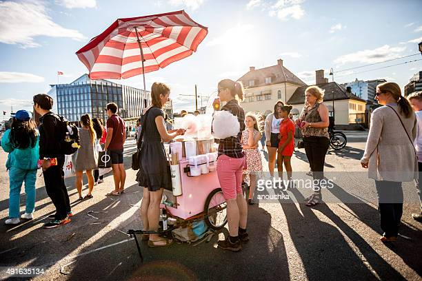 Woman making and selling cotton candy on Oslo Street