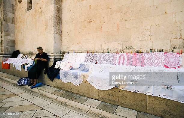 Woman Making and Selling Lace Sheets
