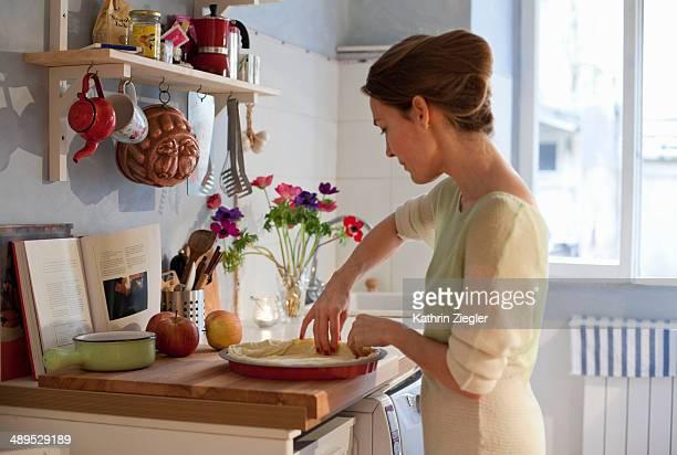woman making apple tart