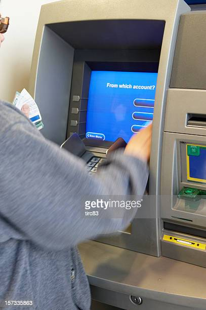 Woman making ATM withdrawal a