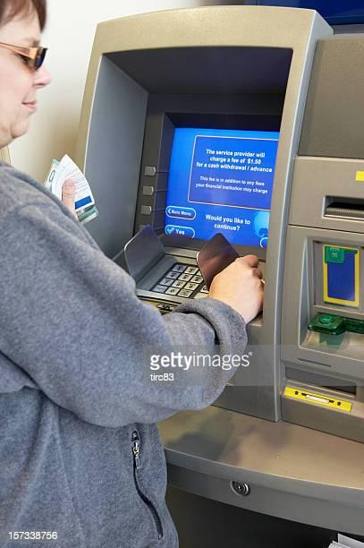 Woman making ATM withdrawal b