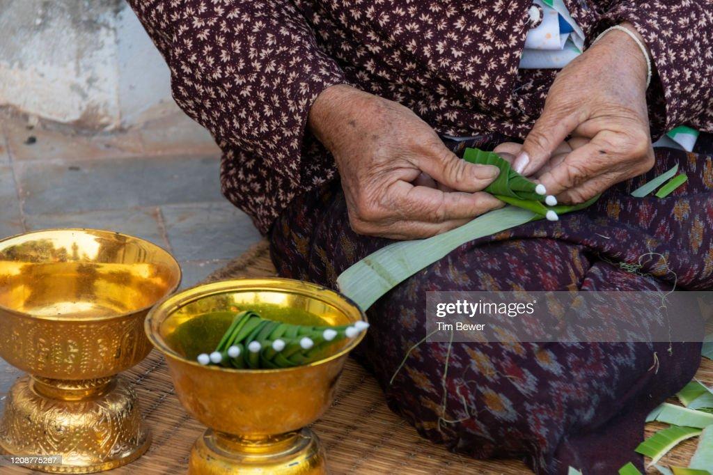 Woman making bai sii decorations. : Stock Photo