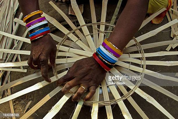 woman making basket - bangle stock pictures, royalty-free photos & images