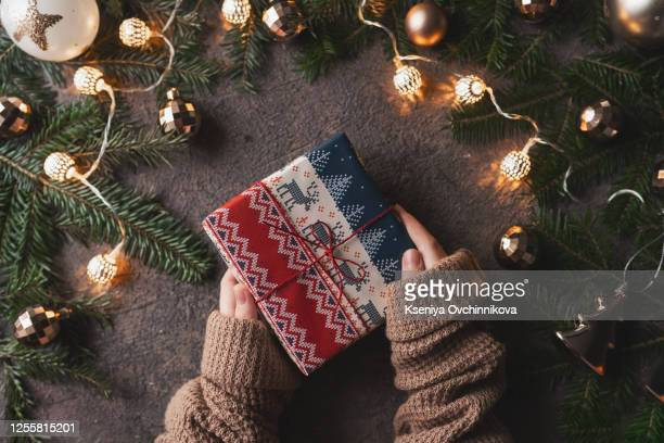 woman making beautiful christmas gift at table - christmas past and christmas present stock pictures, royalty-free photos & images
