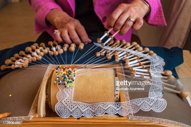 woman making bobbin lace in finland - unesco stockfoto's en -beelden