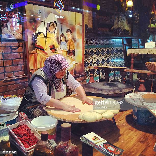Woman making bread in a cafe