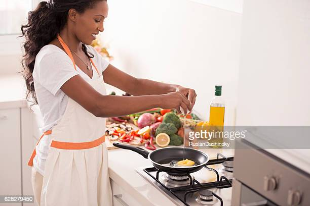Woman making breakfast at kitchen.