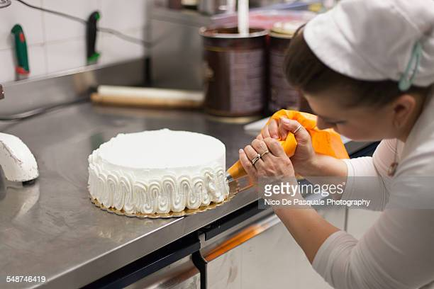 woman making cake - decorating a cake stock pictures, royalty-free photos & images