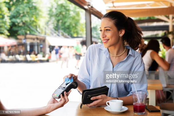 woman making card payment. - greeting card stock pictures, royalty-free photos & images