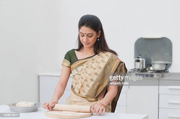 Woman making chapatti in the kitchen