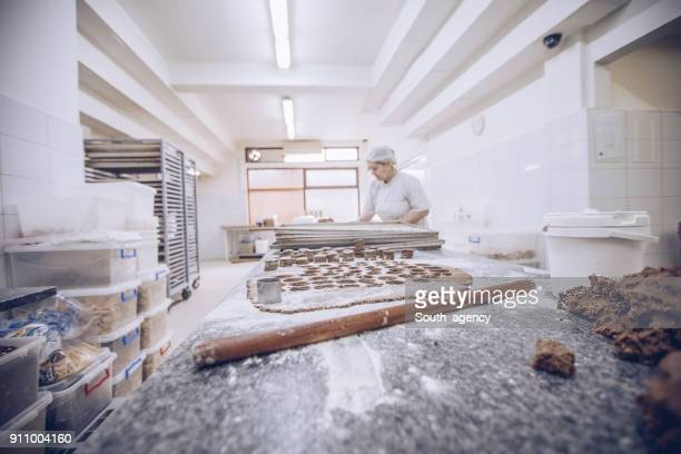 woman making cookies - chocolate factory stock photos and pictures