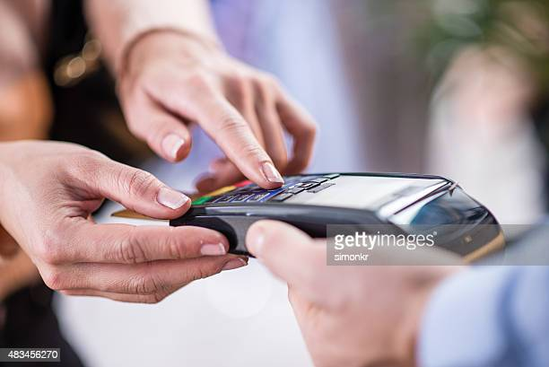 Woman making credit card payment