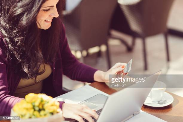 Woman making credit card purchase online