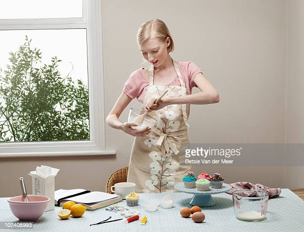woman making cupcakes.