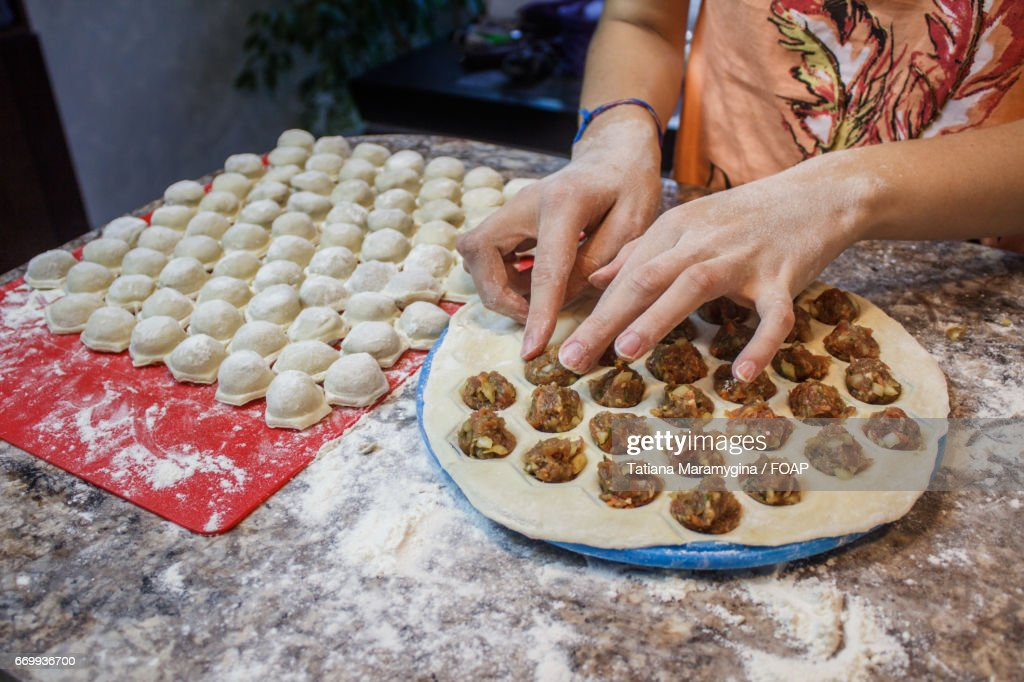 Woman Making Dumplings In Kitchen At Home : Stock Photo