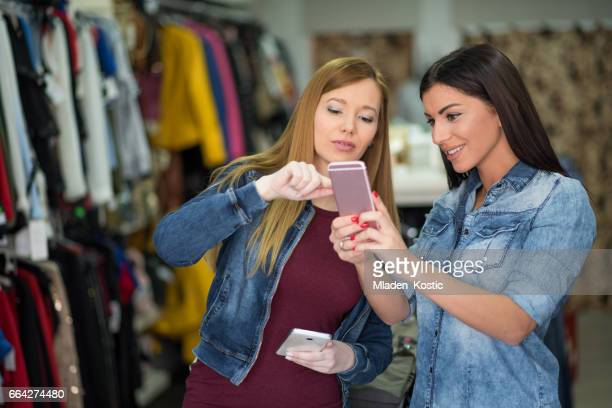 Woman making electronic payment on mobile phone