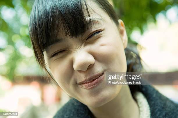 Woman making face, close-up