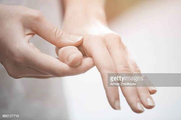 Woman making finger and hand massage