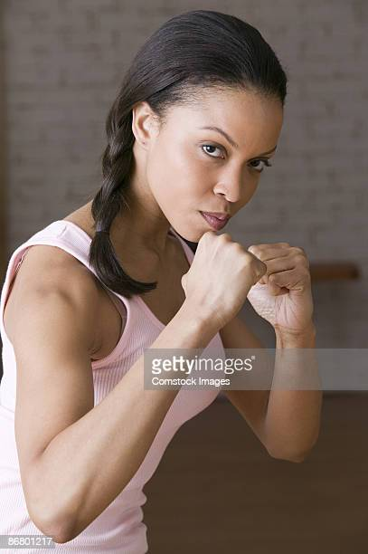 woman making fists - fighting stance stock pictures, royalty-free photos & images