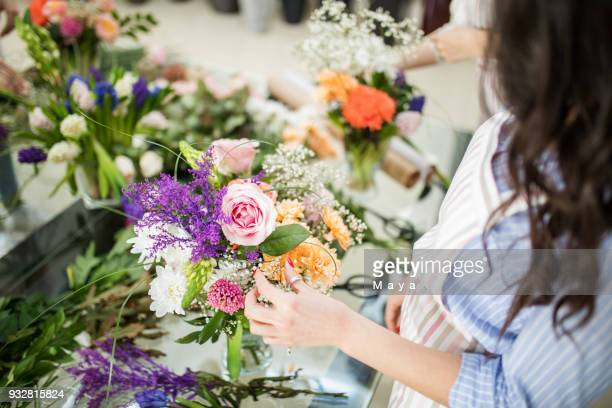 woman making floral decorations - bunch stock pictures, royalty-free photos & images