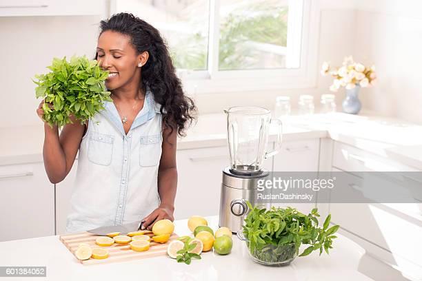 Woman making fresh lemonade.