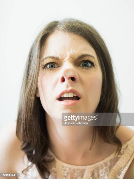 woman making funny face on glass - long nose stock photos and pictures