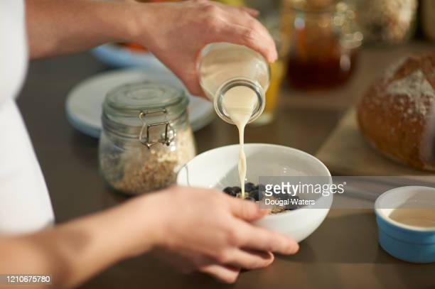 woman making healthy breakfast, close up. - making stock pictures, royalty-free photos & images