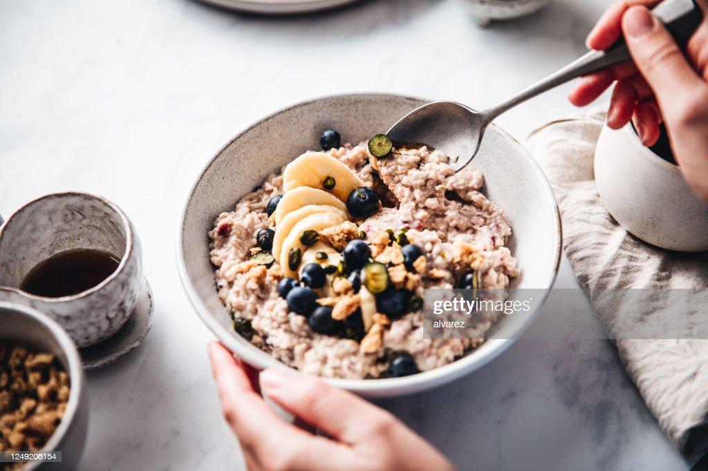 Woman making healthy breakfast in kitchen : Stock Photo