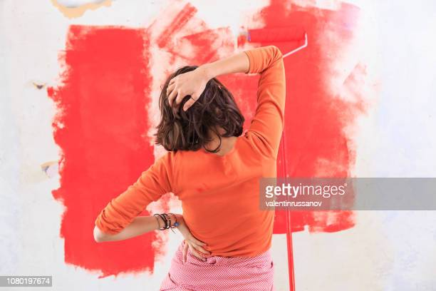 woman making home improvement and having problems - decorating stock pictures, royalty-free photos & images