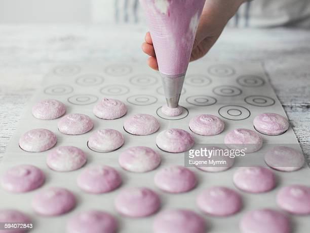 Woman making macarons