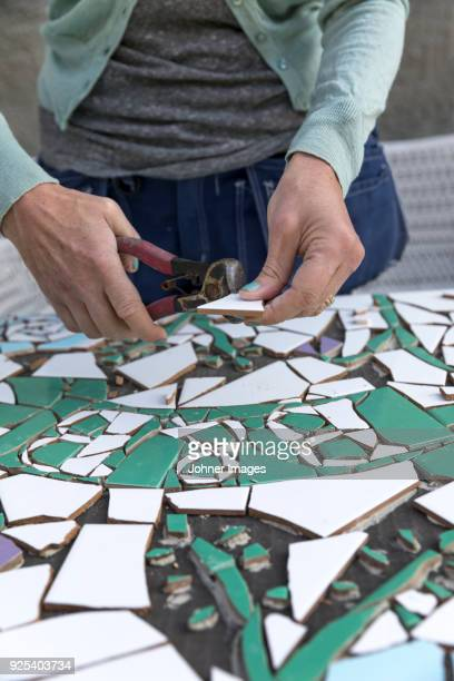 woman making mosaic - mosaik stock-fotos und bilder