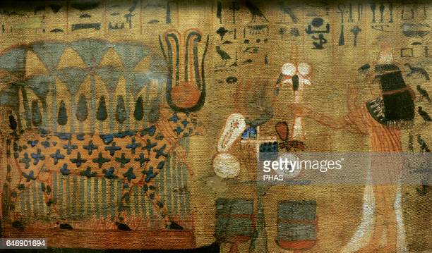 Woman making offerings to the goddess Hathor cosmic divinity represented as cow with spots in the fur horns holding the solar disk and twin feathers...