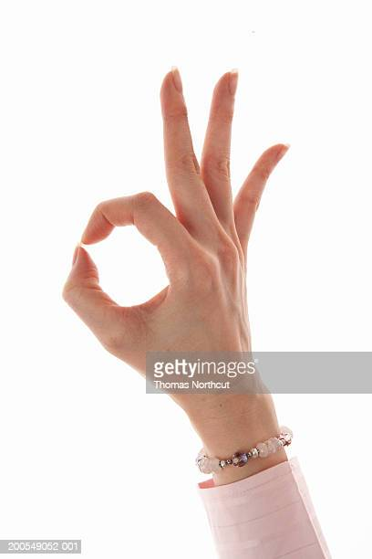 Woman making OK sign, close-up of hand
