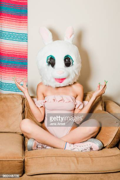 Woman Making Om Symbol Wearing a Bunny Costume