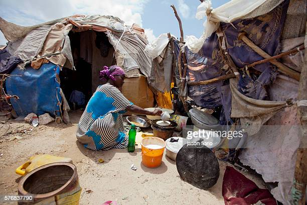 A woman making pancakes from flour supplied by WHO at a camp for Internally Displaced People who have been forced to leave the south of Somalia...