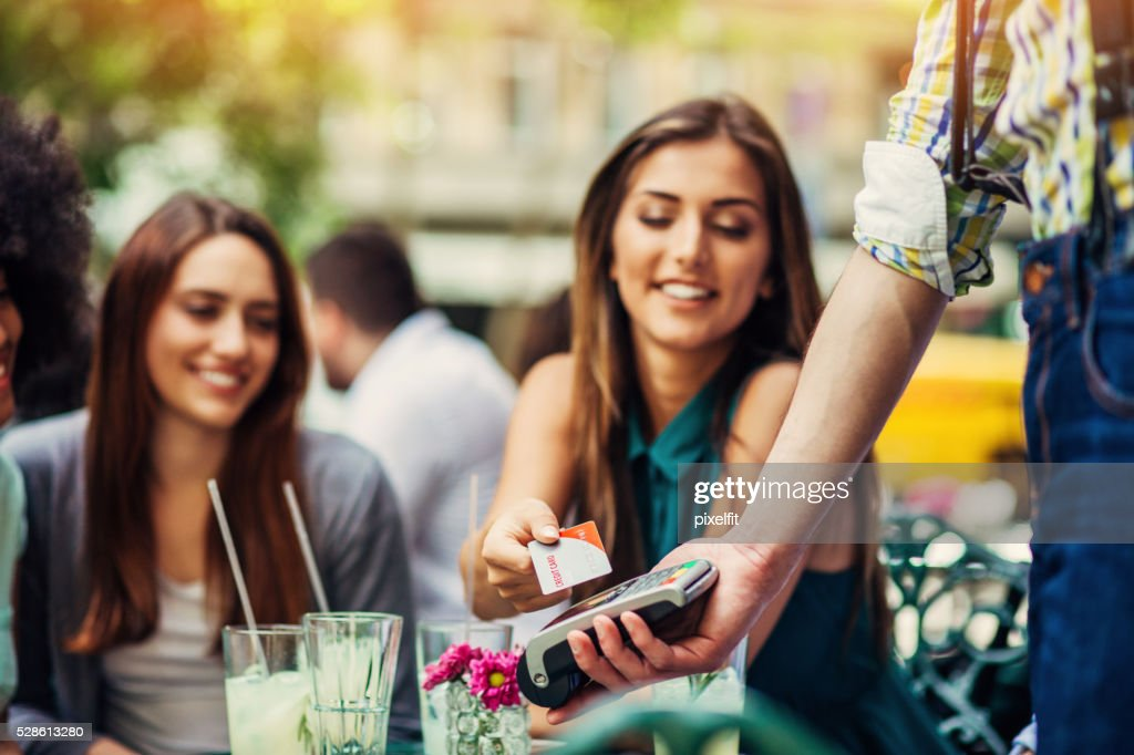 Woman making payment with credit card : Stock Photo