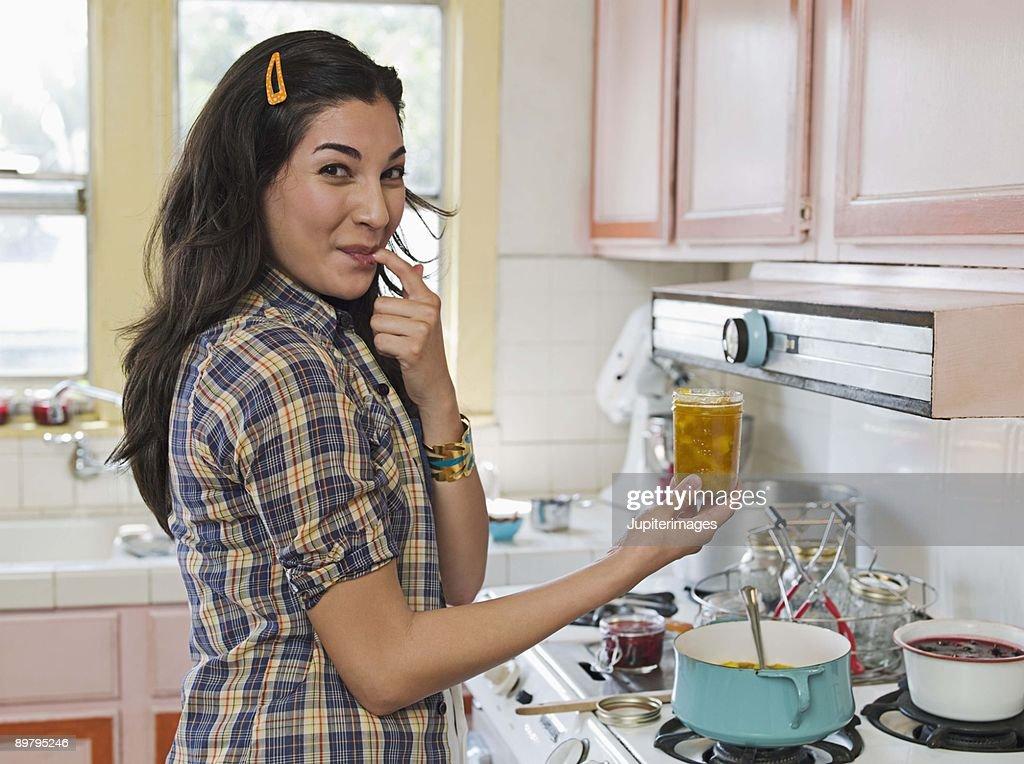 Woman making preserves : Stock Photo