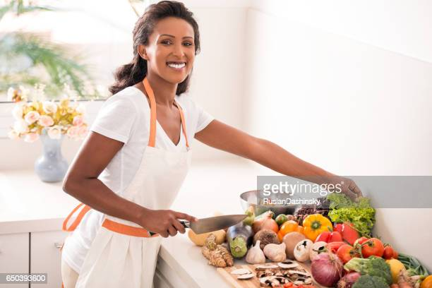 Woman making salad.