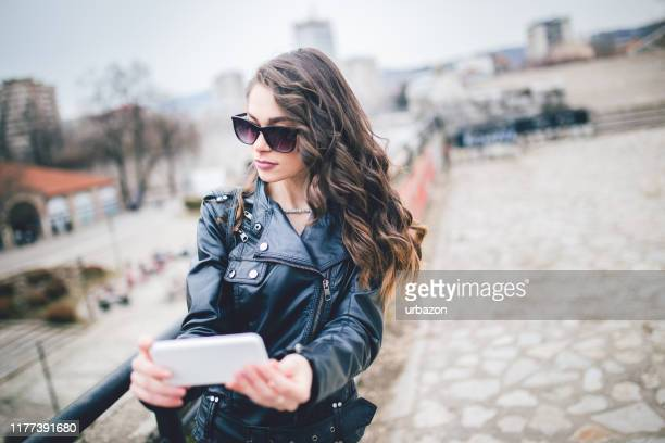 woman making selfie outdoors - wavy hair stock pictures, royalty-free photos & images