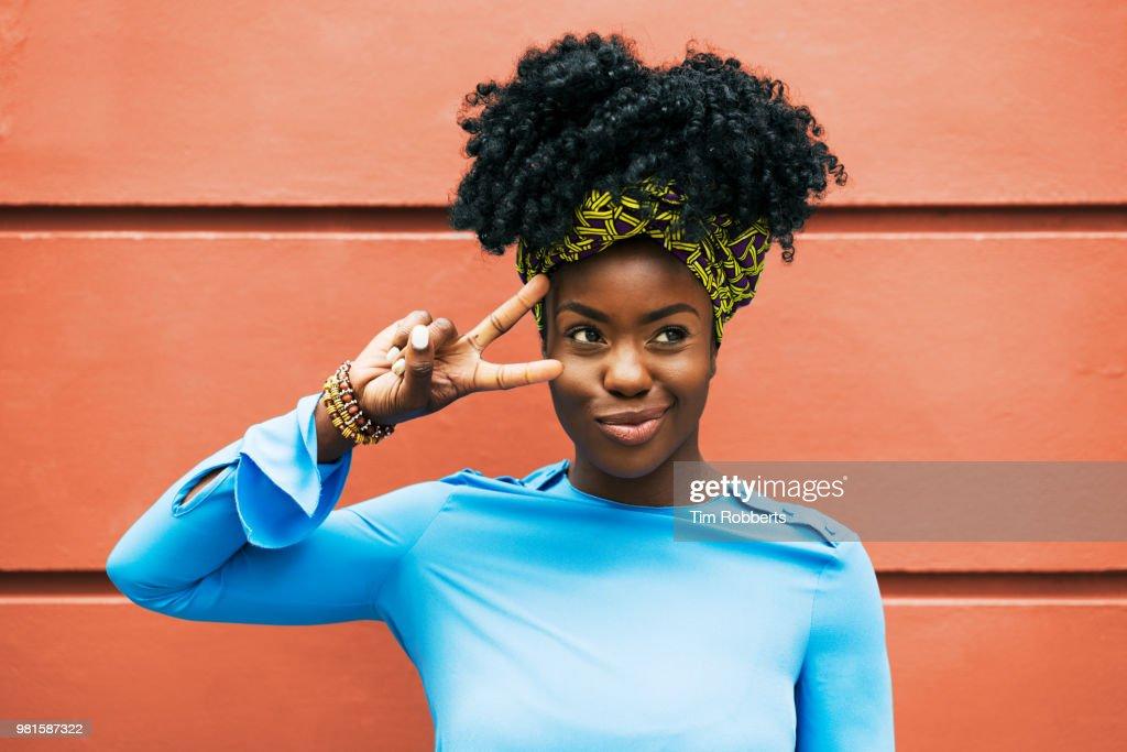 Woman making social media pose : Stock Photo