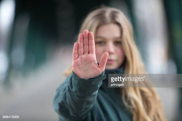 woman making stop gesture - dismissal stock photos and pictures
