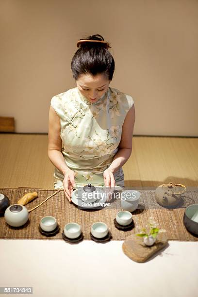 woman making tea - ceremony stock pictures, royalty-free photos & images