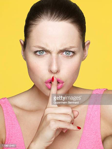 Woman making the be quiet sign