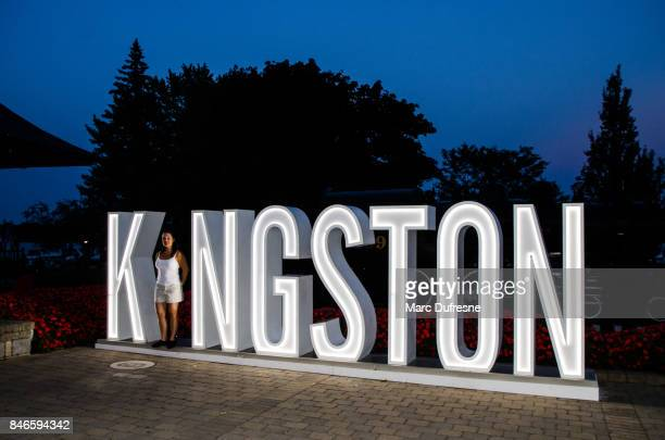 "woman making the letter ""i"" in the illuminated word ""kingston"" at summer night - kingston ontario stock photos and pictures"